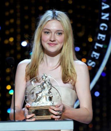 Young Dakota holding Award