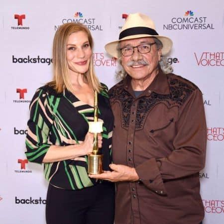 Katee holding her deserving award